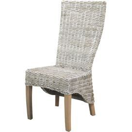 Brimming with heirloom-worthy style and on-trend appeal, this beautifully crafted design offers a storied finishing touch for your d�cor.Product: Accent chairConstruction Material: Wood and fabricColor: Brown and off-whiteFeatures: Solid oak legs  Comfortable wing back design  Skirt rattan design element       Dimensions: 41.7 H x 18.9 W x 24.4 D