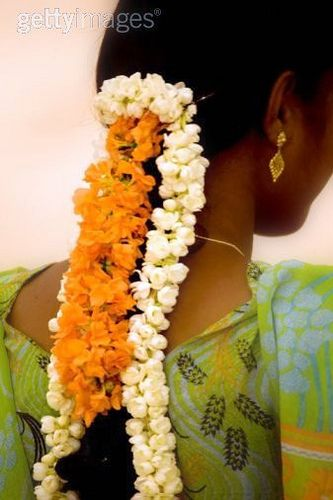 jasmine flowers in her hair