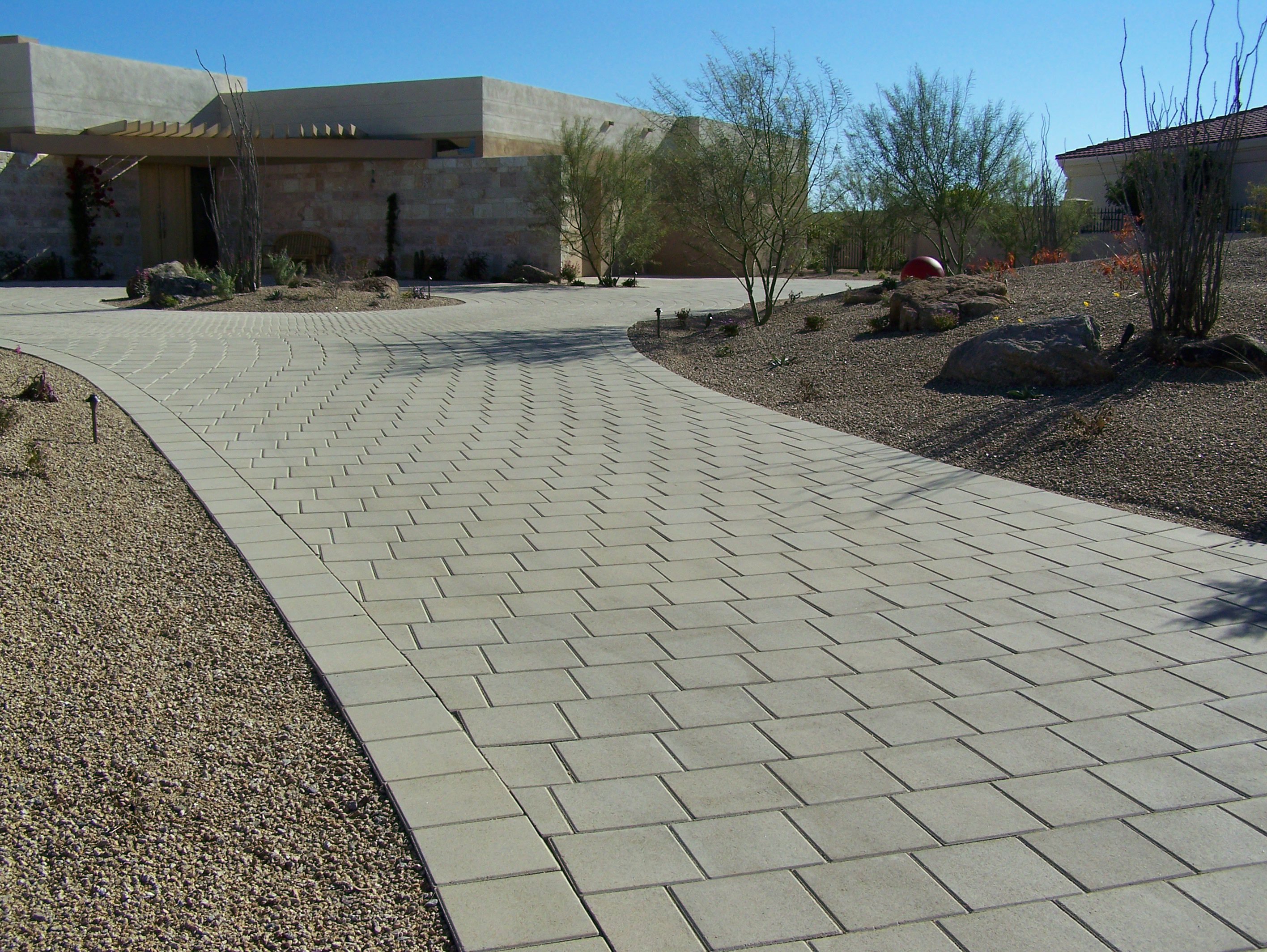 Simple yet elegant driveway with our 12 x 12 pavers ackerstone