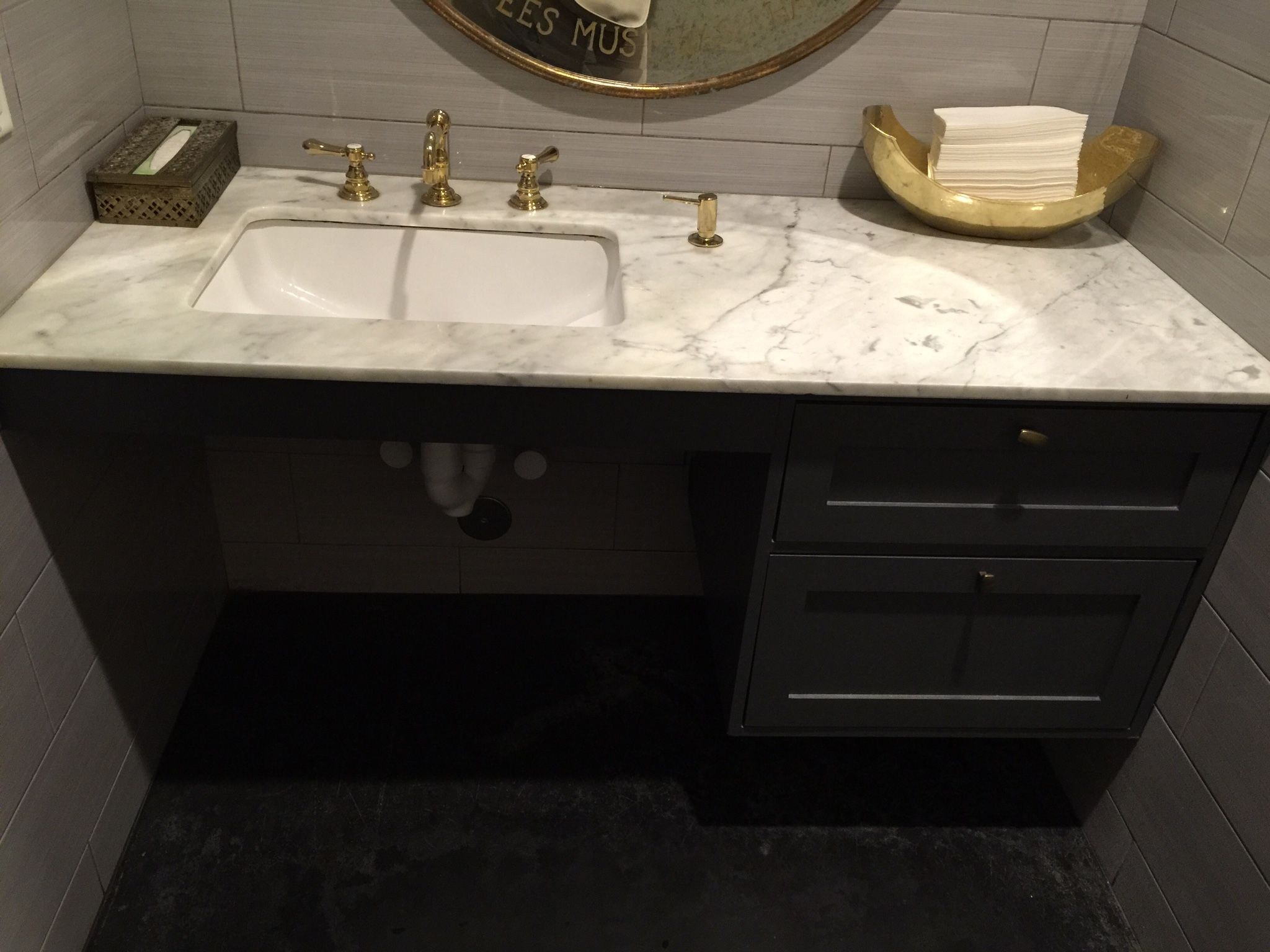 Shelve under sink for towels and one large pull out drawer ranch