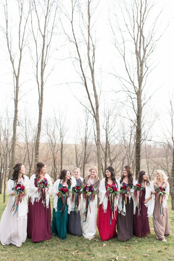 76b2c3078bb Rachel s bridesmaids donned mismatched chiffon dresses in a mix of jewel  tones and woodsy neutrals. Cream-colored pashminas completed the look.