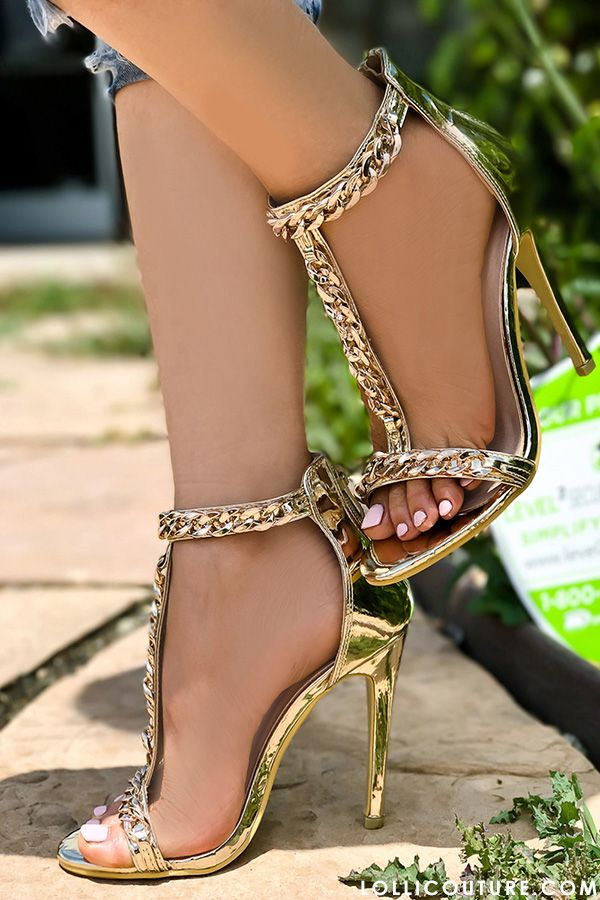 These heels feature a T strap with chain accent, open toe