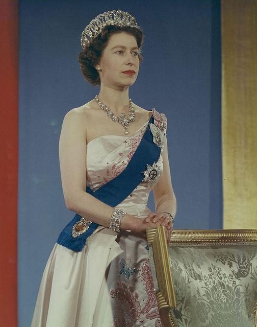 Queen Elizabeth Ii Wearing Crown Blue Sash And Pink Gown