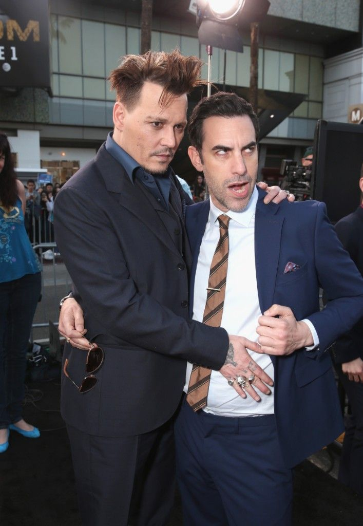 johnny depp sacha baron cohen get handsy alice through the looking glass premiere