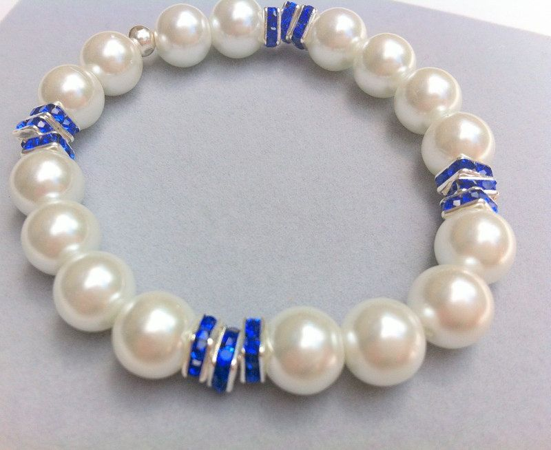 Bridal bracelet bridesmaids weddings mother of the bride sparkly holiday jewelry prom sparkly swarovski elements sapphire blue and pearls - pinned by pin4etsy.com