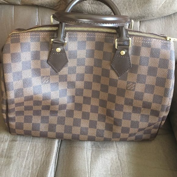 Louis Vuitton speedy 30 bag Beautiful Louis Vuitton used a handful of times. Has serial number as pictured and key inside for outside lock. No real signs of wear. Serious offers only please. Price firm Louis Vuitton Bags Satchels