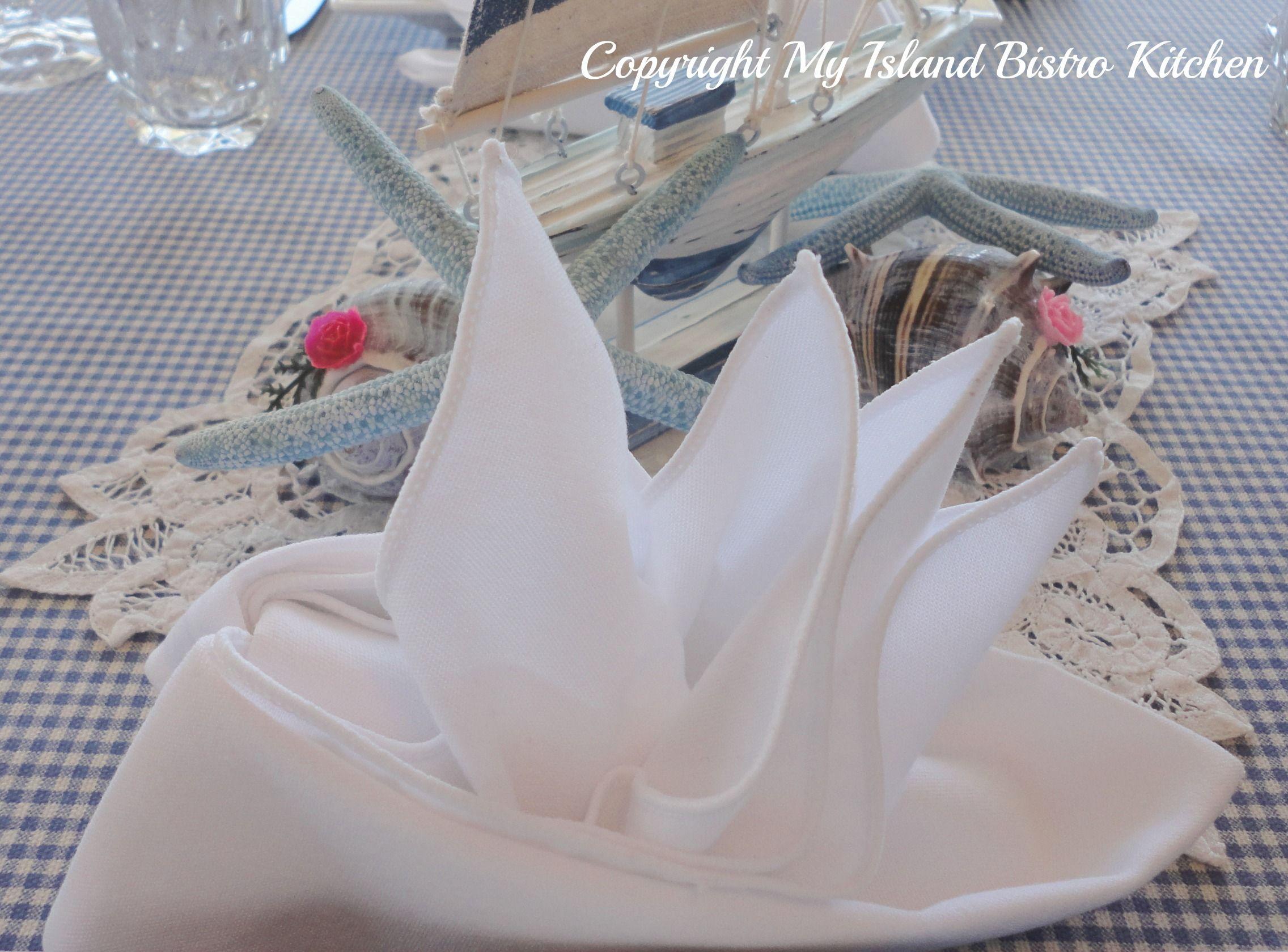 Napkin folding instructions for the pyramid napkin fold - Sailboat Napkin Fold