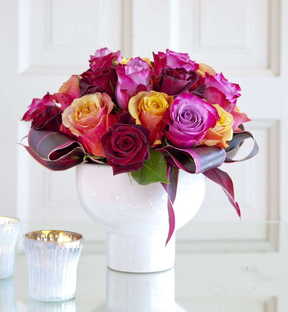 A compact display of 30 roses in complimentary colors. Gorgeous ...
