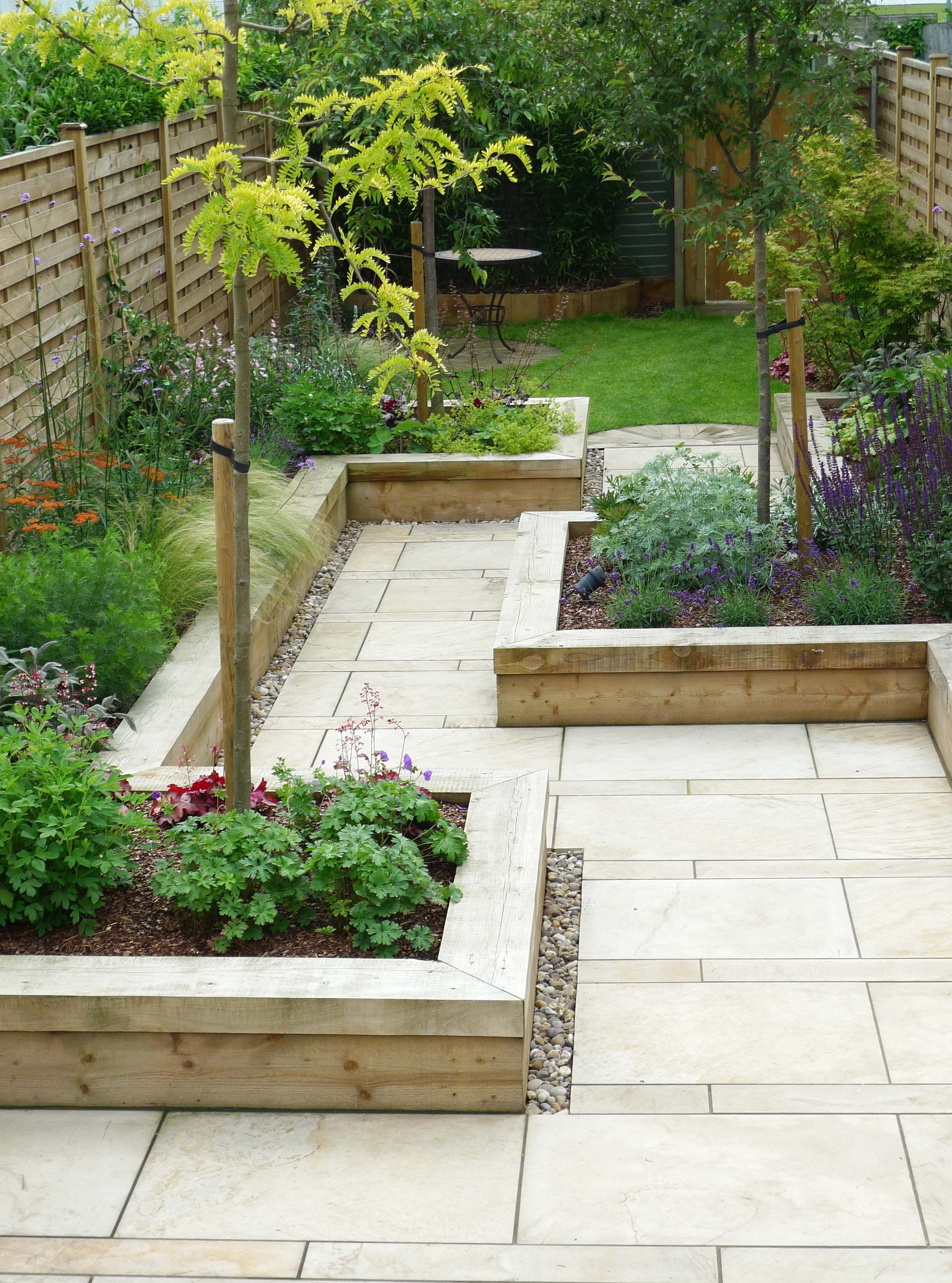 Enchanting Small Garden Landscape Ideas With Stepping Walk: Raised Bedding Walkway In Backyard...but Gravel And