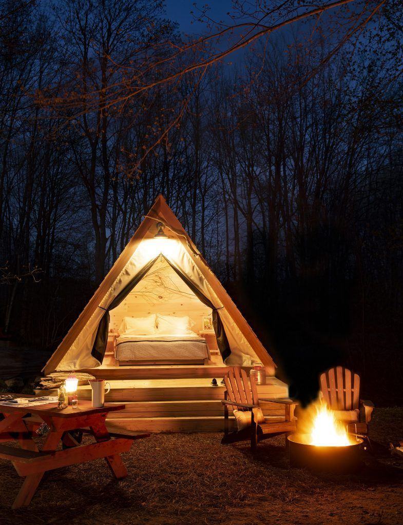 Stay in rustic new cabins and huts at this beautiful Maine campsite