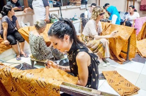 Italian young designer Giorgia Donia learns to make batik in Laweyan batik village, Surakarta, Central Java, Indonesia. Donia is a graduate of one of Italy's oldest fashion schools, Koefia, that has included batik in its curriculum as part of a cooperation program with the Indonesian Embassy in Italy to enrich its batik design to breach the international market.