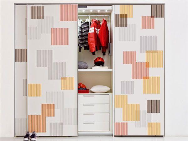 White Patterned Sliding Door Kids Wardrobe Design In White