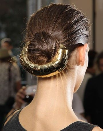 Embellished Updo: secure hair teased chignons with cage barrettes, hair pins and errant strands.
