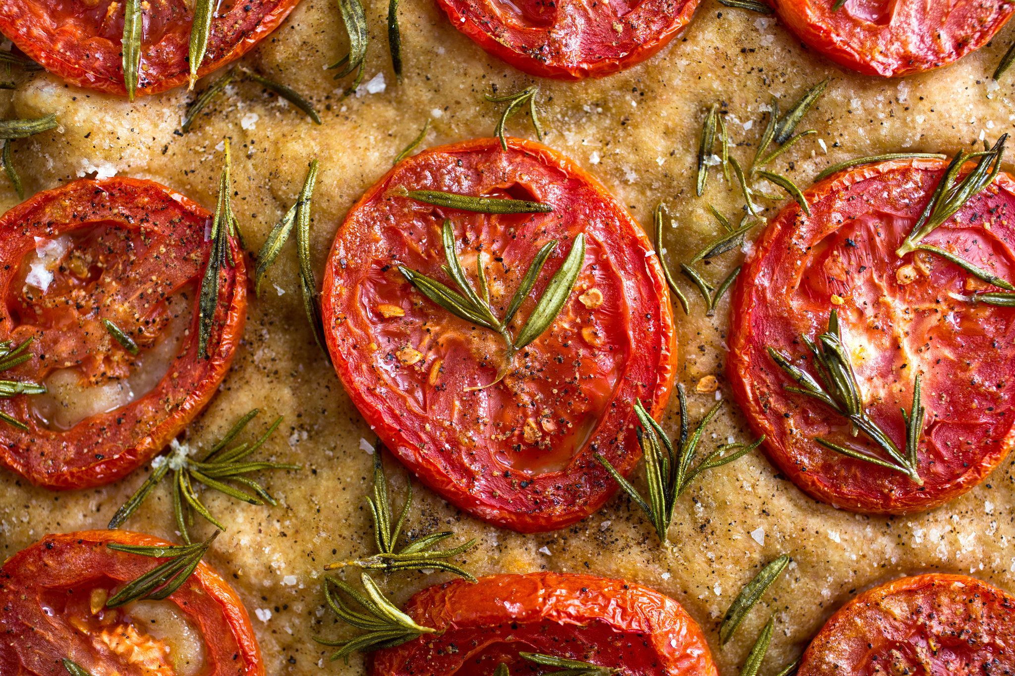 This beautiful bread is really a summer focaccia, but I found some good tomatoes at my farmers' market and used them They should just begin to color on the edges in the oven.
