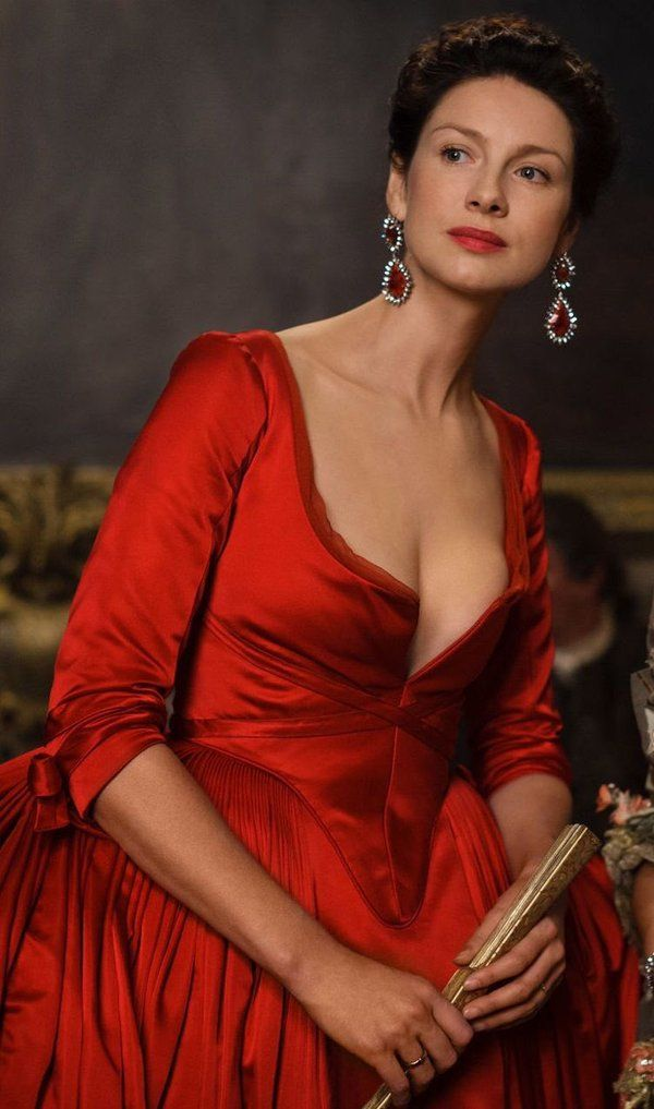 ~ Caitriona Balfe as Claire Fraser wearing a scarlet red panier dress with corseted bodice and plunging neckline. The costumes were designed by Terry Dresbach. Outlander (2016)