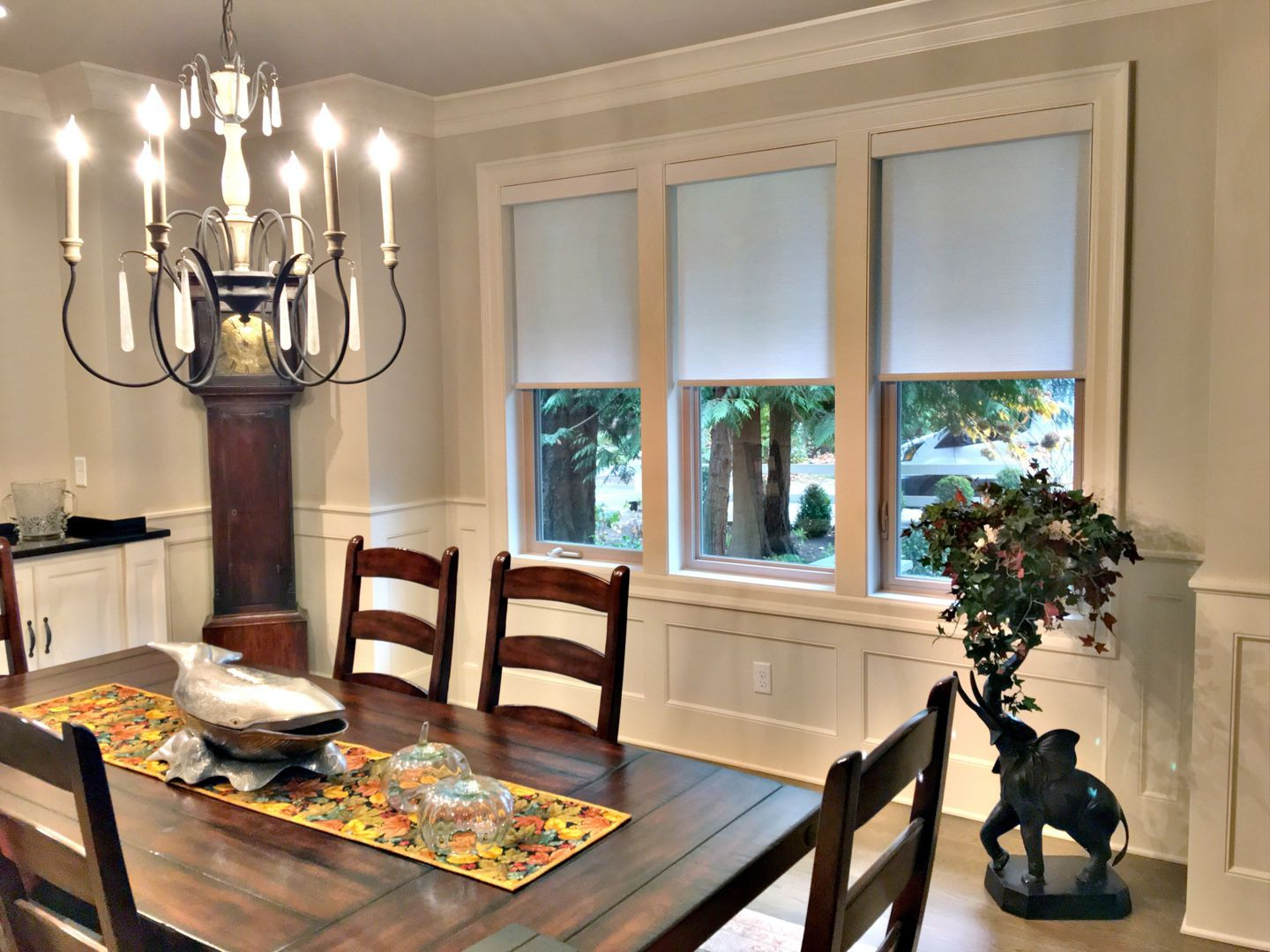 Roller Shades In A Dining Room Featuring A Classic Grandfather