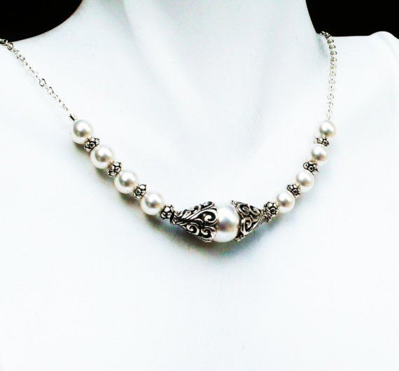 http://www.etsy.com/listing/46844773/bali-silver-and-pearl-necklace-antiqued