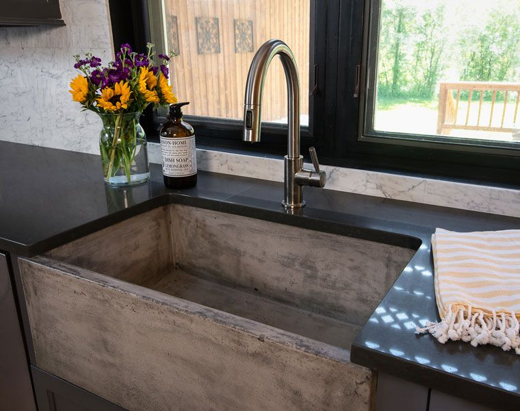 Concrete farmhouse sink in this kitchen remodel by reDesign Home LLC ...