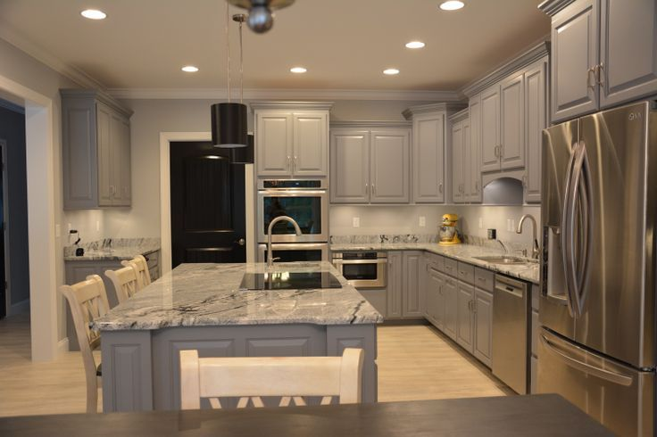Kitchen, Grey Cabinets Viscon White Granite and Black Interior Doors. White  Washed Oak Laminate Flooring.