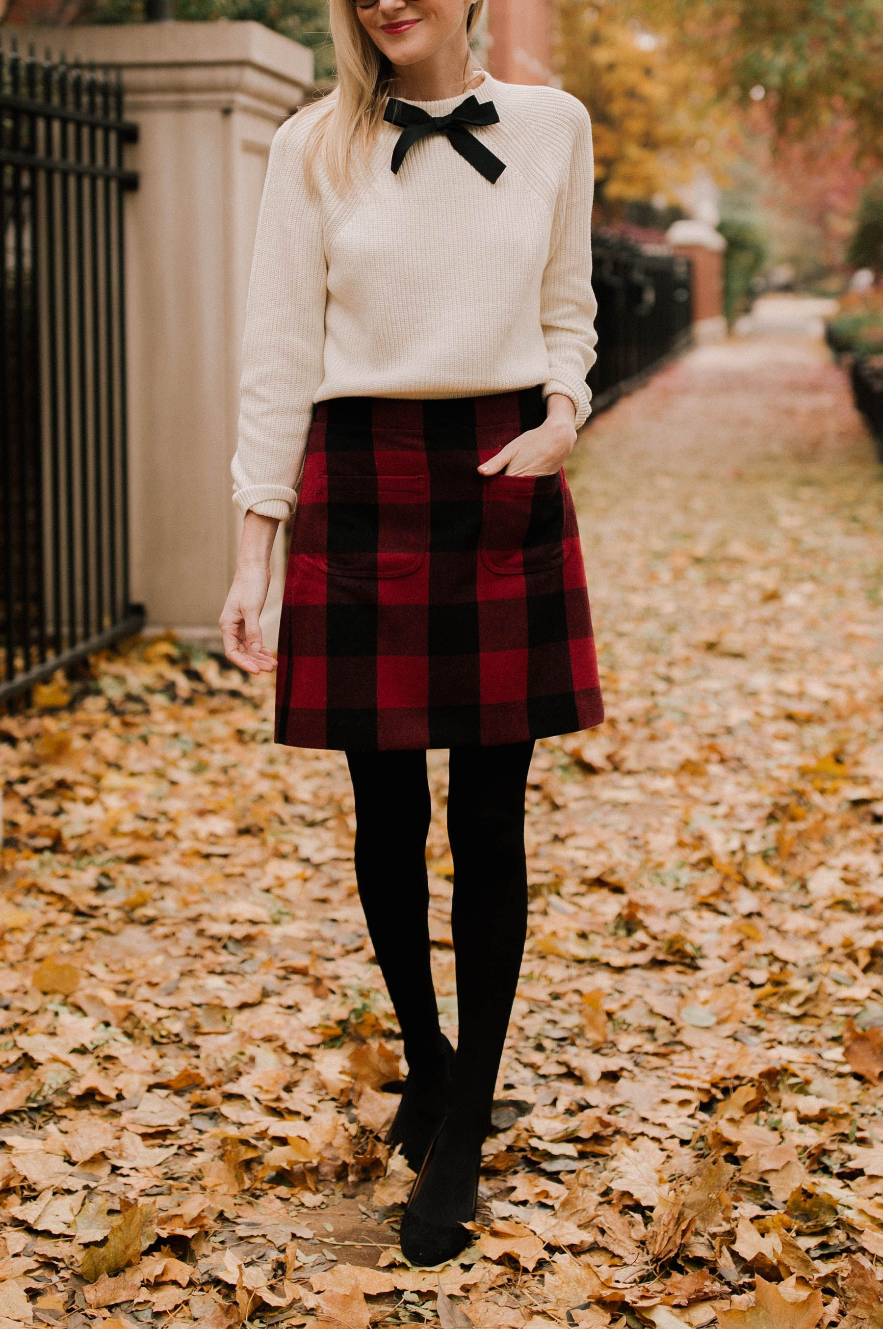 6052942d3f84 Preppy Holiday party outfit. Pair this plaid skirt with a white sweater  with a bow on it! Add tights and booties and you're good to go!