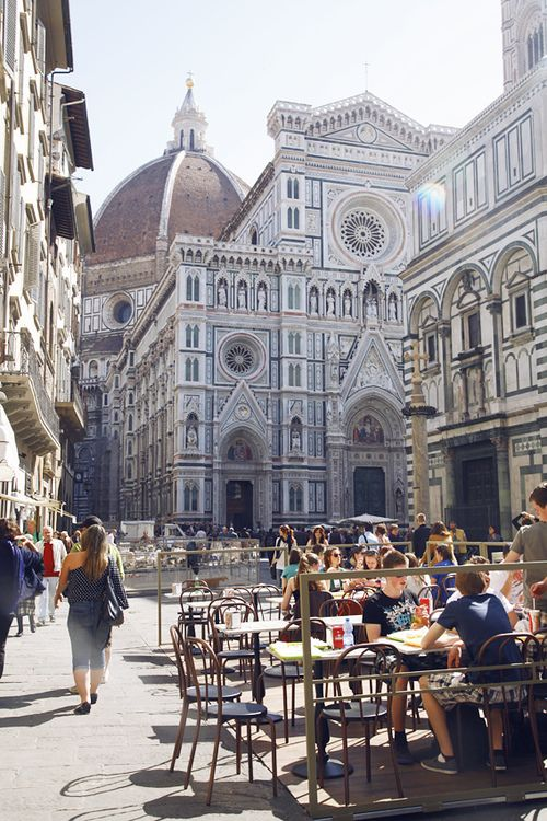 Walkside cafe in Florence, Italy, with view of the Cathedral and Duomo