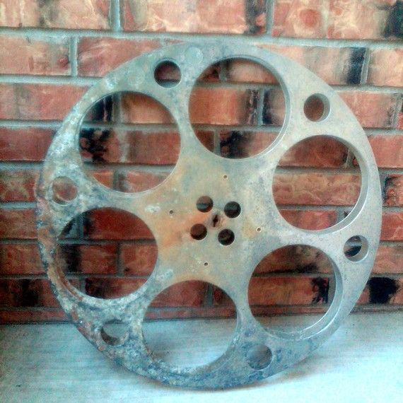 Calling All Critics  Very Antique Movie Film Reel  by queganga