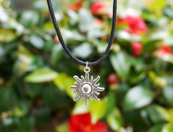 This is a vegan black waxed cord choker necklace featuring an antiqued silver plated sun charm.  Please choose your desired necklace length at