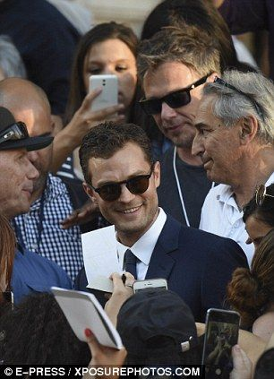 In demand: The 26-year-old acting superstar and Jamie were mobbed by fans wanting selfies and autographs as they left the exclusive Grand-Hotel