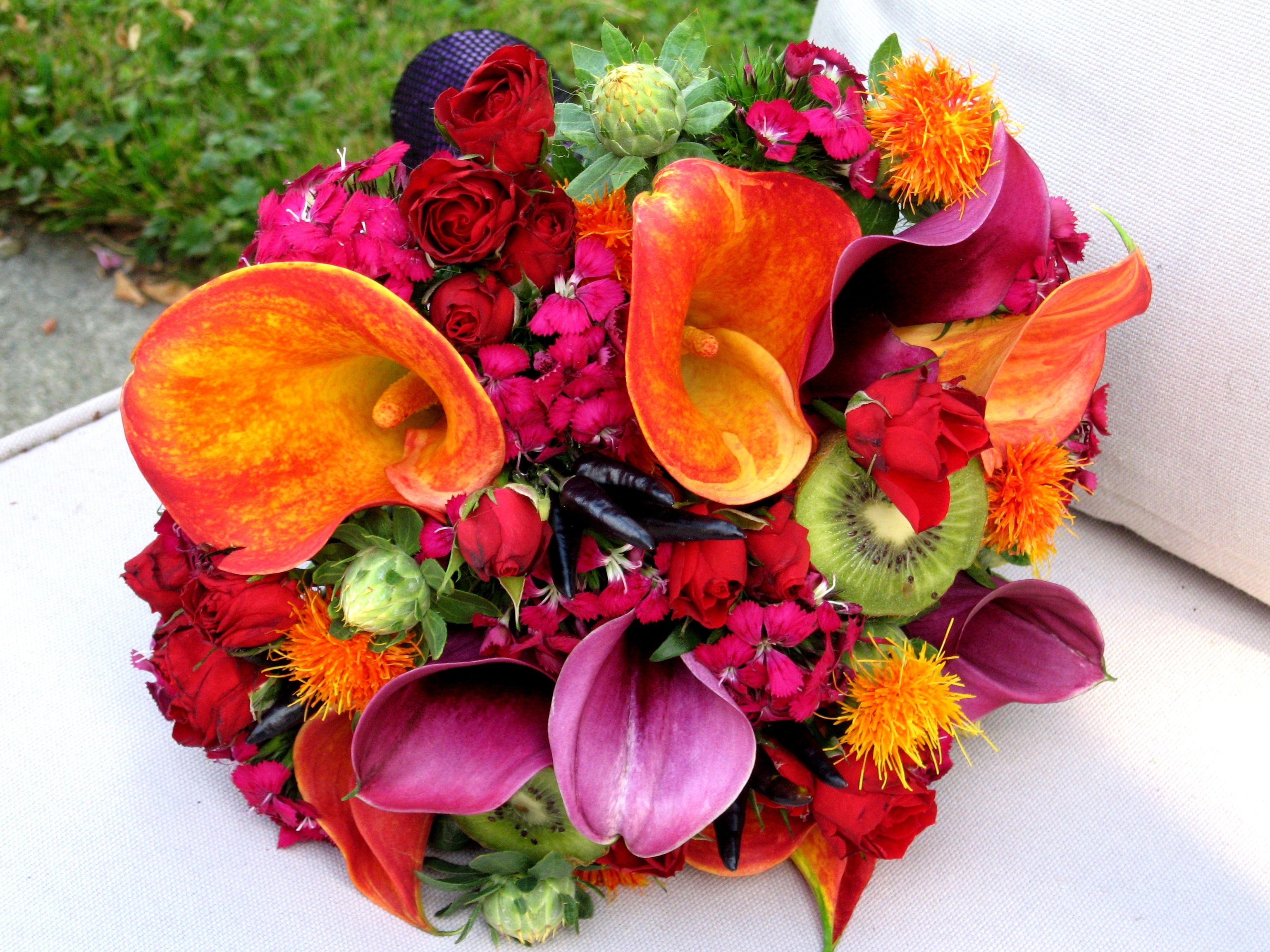 Spicy bouquet with hot peppers, kiwi and wrapped in fish net stockings  Designed by Flowers by Antonella