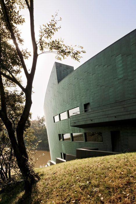 Sanaksenaho architects constructs copper clad cipea villa in nanjing