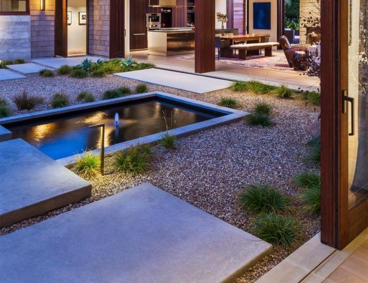kiesbeet-teich-ziergraser-moderner-landschaftsbau Garten - terrassengestaltung mit wasserbecken