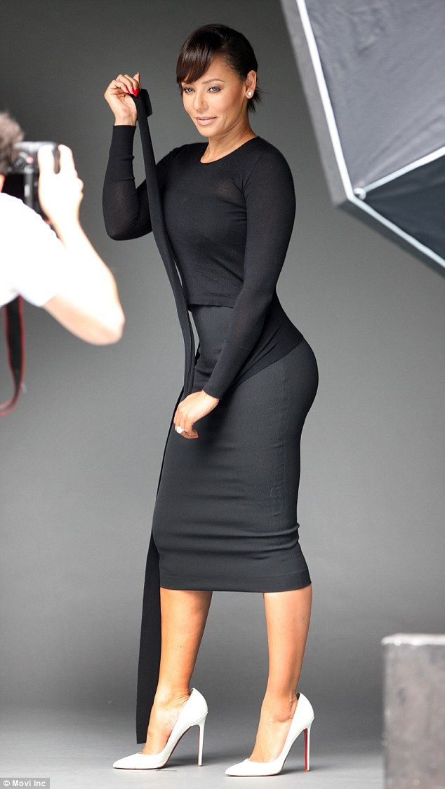 a1826805b0b Working it  The former Spice Girl rocked a sophisticated black dress that  perfectly framed.