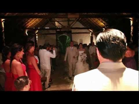 02.26 chapel, coconuts and candles white petals in aisle white arrangement at front. then la isla