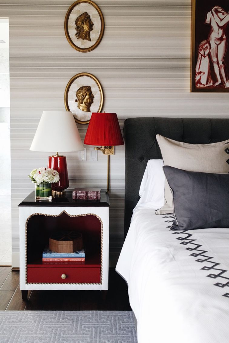 Master bedroom in the Seattle Showhouse. Love the bold red and more traditional yet modern design.