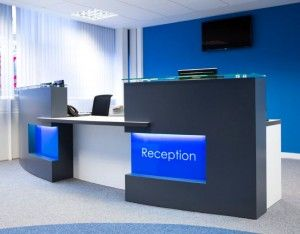 blue white office space. monolith reception desk in graphite grey white and blue office space u