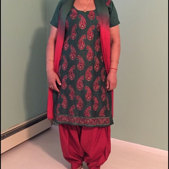 Green and red embroidered salwar suit