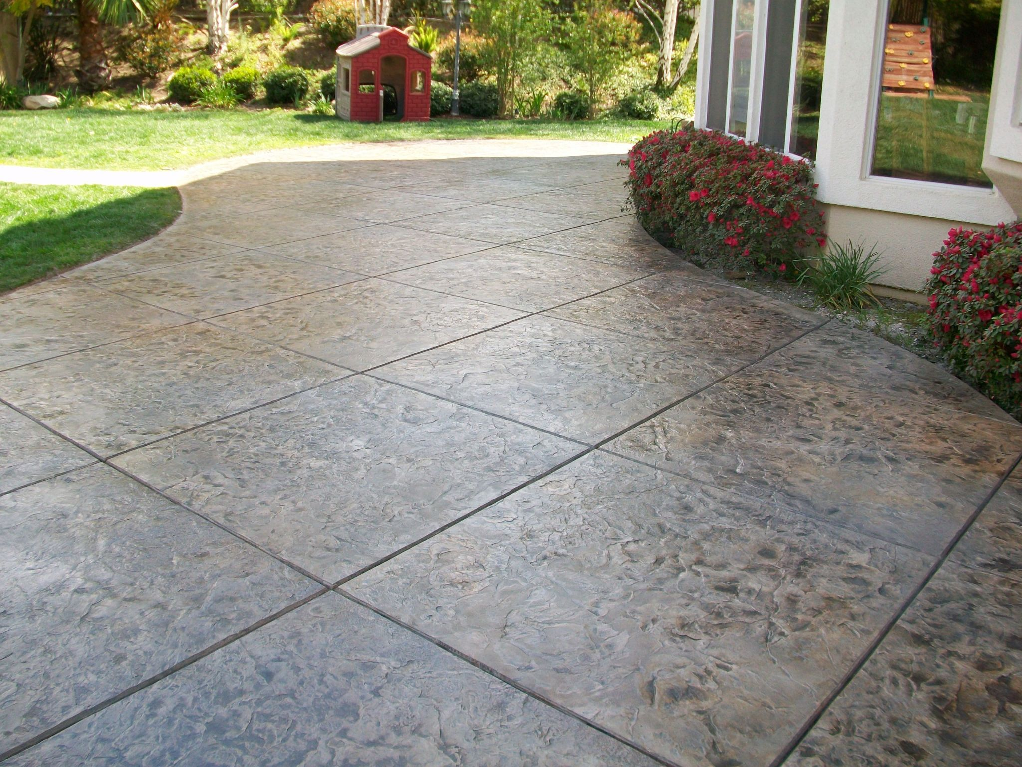 Stamped concrete designs are able to provide the same beauty of a ...