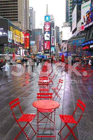 Red Tables And Chairs In Cold Wet Times Square Stock Photo 55432906 Times Square New York Times Square City Photography