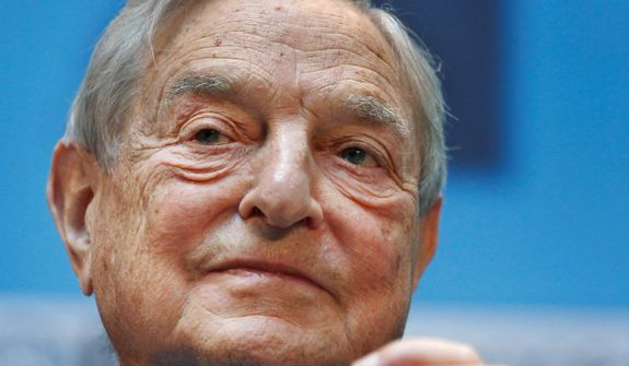 "Billionaire George Soros has taken an eagle's eye approach to funding the Ferguson activities of Al Sharpton, the ""Hands Up, Don't Shoot"" campaign and protests linking Michael Brown's and Trayvon Martin's deaths. (Associated Press)"