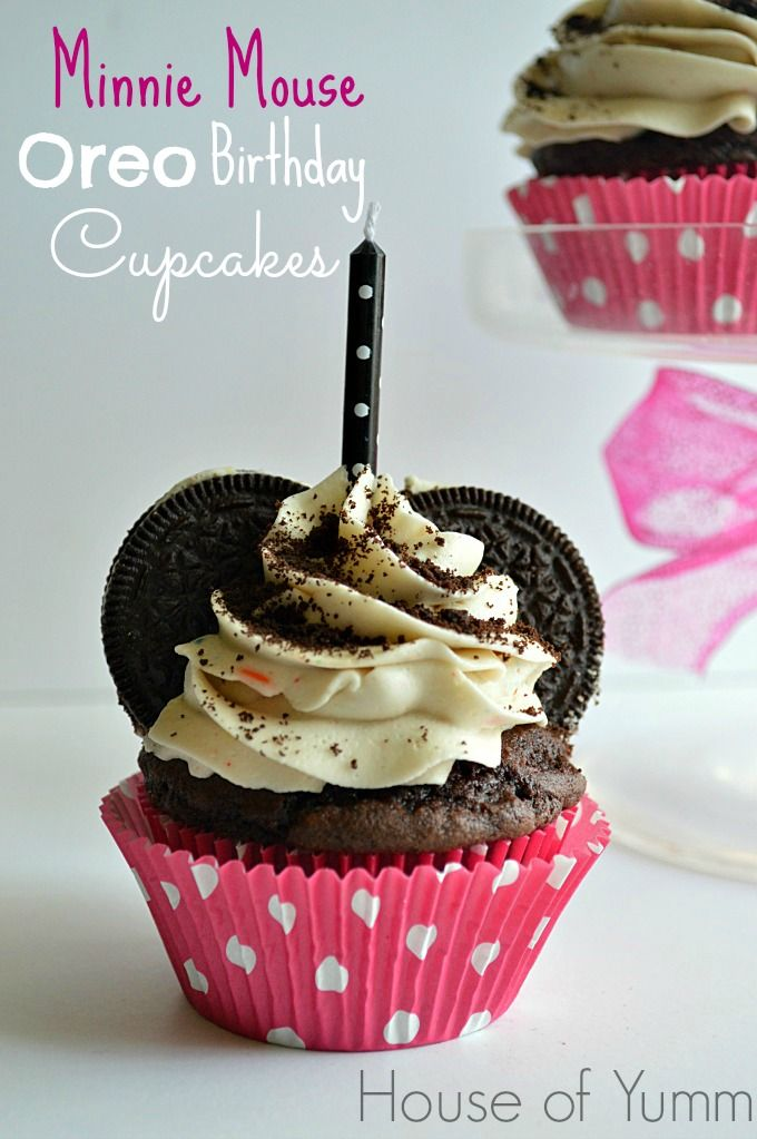 These chocolate cupcakes are topped with an Oreo Birthday Cake frosting and decorated to resemble Minnie Mouse!  Perfect addition to any little girl's birthday party