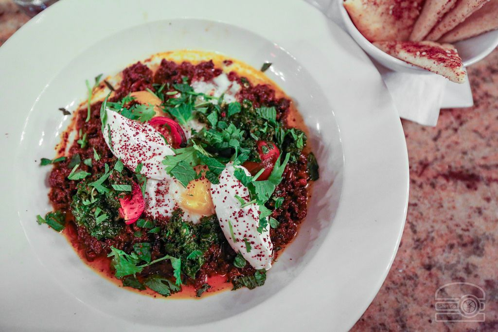 Jerusalem Dish With Intense Flavors - Spiced Ground Lamb Braised Farm Egg Cherry tomatoes Lemon Tahini Labneh Zhoug and Pita[OC][2590x1797] - see http://www.classybro.com/ for more!