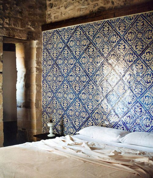 So. Much. LOVE. I was thinking of stenciling a design like this on one of my bedroom walls, but to go full out with panels? And with that gorgeous rock wall behind! So beautiful. I'd never leave this room.