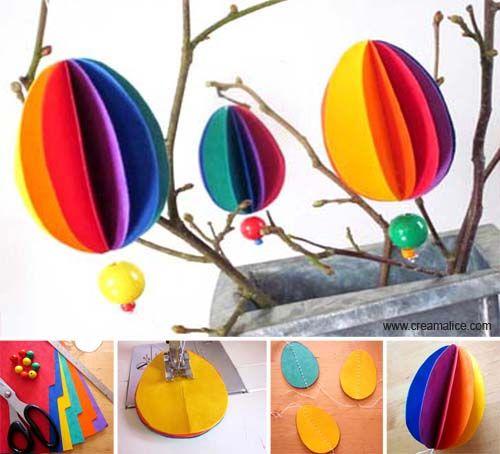 De jolis petits œufs en millefeuille de papiers colorés à suspendre sur de  légers branchages, voilà une belle idée {DiY} pour une déco de Pâques  originale !