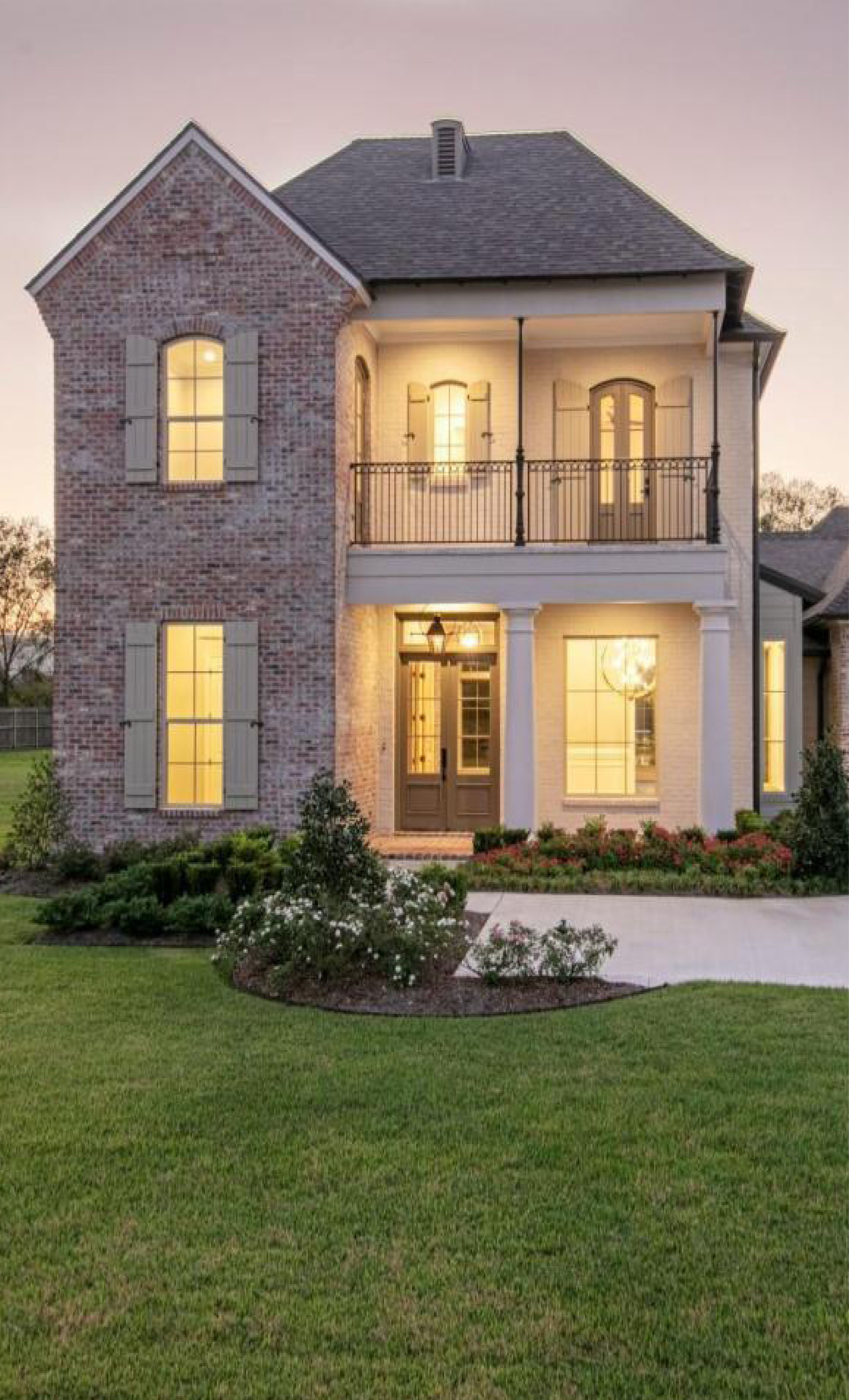 Beautiful two-story home in Lafayette, LA with light tan ...