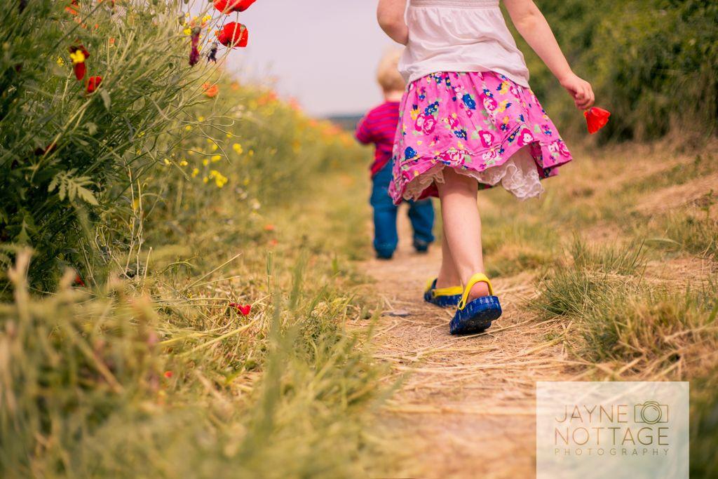 Walking amongst poppies. Canterbury, Kent.