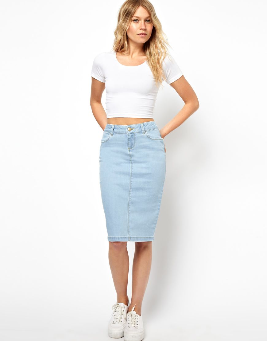 Distressed denim pencil skirt. 90's grunge shirt tied around the ...