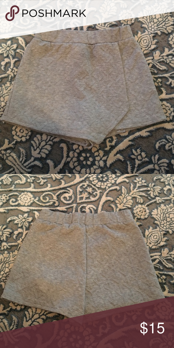 Gray skort Gray skort from the boutique RiffRaff. Barely worn. Timing Shorts Skorts