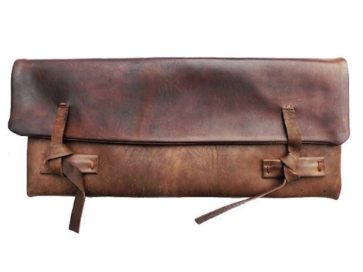 Type: Clutch / Color: Brown / Details: Tie Enclosure / Material:  Leather / Brand: Unknown  / Style: Unknown