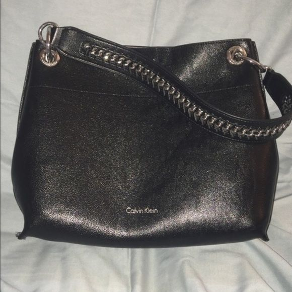 Reversible Calvin Klein Shoulder Bag Gorgeous Calvin Klein shoulder bag. Can be reversed to a shiny light gray. Bag comes with bottom insert (to keep it standing upright), two additional straps and a wristlet! New without tags! #NWOT Calvin Klein Bags Shoulder Bags