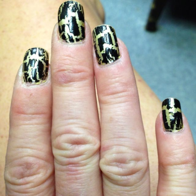 Gold nail polish with Avon black crackle top coat.